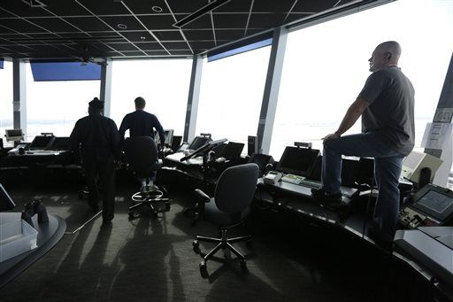 In this 2015 photo, air traffic controllers monitor traffic in the control tower at O'Hare International Airport in Chicago.