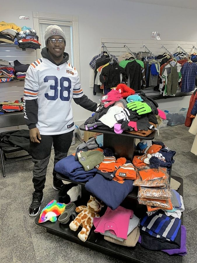 Kerrith Whyte assists with organizing clothing available in the Welcome Center at the MHS District 120 Office Building.