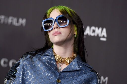 FILE - This Nov. 2, 2019 file photo shows Billie Eilish at the 2019 LACMA Art and Film Gala in Los Angeles. Eilish will be the first recipient of the Apple Music Award for global artist of the year, one of three honors for the pop singer. Apple announced Monday that Eilish's 'œWhen We All Fall Asleep, Where Do We Go?'� has been named album of the year.  Eilish and her brother Finneas will also receive songwriter of the year honors. (Photo by Jordan Strauss/Invision/AP, File)