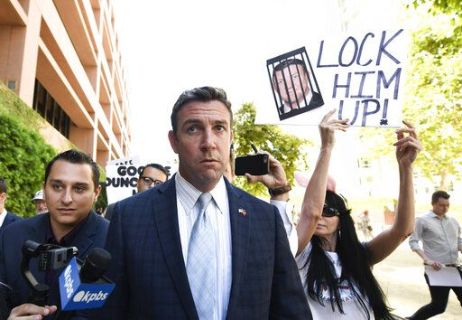 CORRECTS TO ATTRIBUTE THE REFERENCE TO HUNTER, NOT A JUSGE - FILE - In this July 1, 2019, file photo, U.S. Rep. Duncan Hunter leaves federal court after a motions hearing in San Diego. The California Republican plans to plead guilty on Tuesday, Dec. 3, 2019, to the misuse of campaign funds and has indicated he will leave Congress, he told KUSI television in San Diego in an interview that aired Monday.
