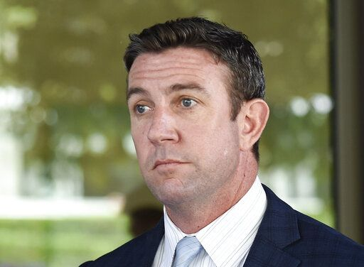 CORRECTS TO ATTRIBUTE THE REFERENCE TO HUNTER, NOT A JUSGE - FILE - In this July 1, 2019, file photo, U.S. Rep. Duncan Hunter leaves federal court after a motions hearing in San Diego. U.S. Rep. The California Republican plans to plead guilty on Tuesday, Dec. 3, 2019, to the misuse of campaign funds and has indicated he will leave Congress, he told KUSI television in San Diego in an interview that aired Monday.