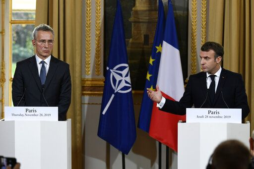 "French President Emmanuel Macron, right, and NATO Secretary General Jens Stoltenberg, hold a joint press conference at the Elysee palace, Thursday, Nov.28, 2019 in Paris. French President Emmanuel Macron said the NATO needed ""a wake up call"" and that its leaders must have a strategic discussion about how the military alliance should work, including on improving ties with Russia. (Bertrand Guay, Pool via AP)"
