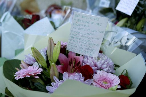 A tributes message with flowers, placed by the southern end of London Bridge in London, Monday, Dec. 2, 2019. London Bridge reopened to cars and pedestrians Monday, three days after a man previously convicted of terrorism offenses stabbed two people to death and injured three others before being shot dead by police.