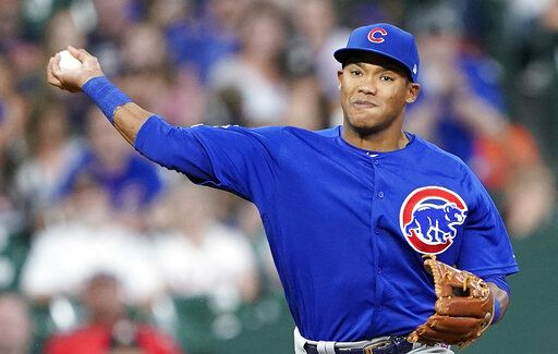 FILE - In this May 29, 2019, file photo, Chicago Cubs shortstop Addison Russell throws to first during the eighth inning of a baseball game against the Houston Astro in Houston. The Cubs failed to offer a 2020 contract to Russell on Monday, Dec. 2, 2019, making the 2016 All-Star a free agent one year after he was suspended for violating Major League Baseball's domestic violence policy.