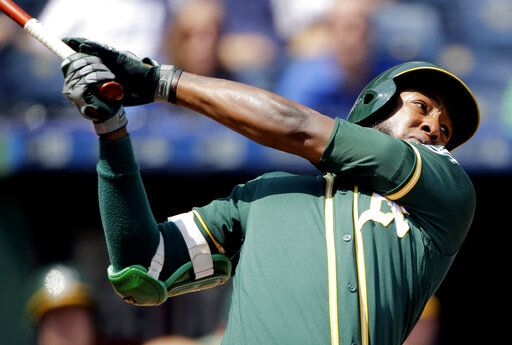 FILE - In this Aug. 29, 2019, file photo, Oakland Athletics' Jurickson Profar watches his two-run home run during the fourth inning of a baseball game against the Kansas City Royals in Kansas City, Mo. Switch-hitting second baseman Profar has been acquired by the San Diego Padres from the Athletics in exchange for catcher Austin Allen and a player to be named. The trade was announced Monday, Dec. 2, 2019, with the baseball winter meetings in San Diego less than a week away.
