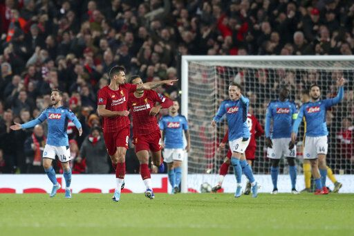 Liverpool's Dejan Lovren, second left, celebrates scoring his side's first goal during the Champions League Group E soccer match between Liverpool and Napoli at Anfield stadium in Liverpool, England, Wednesday, Nov. 27, 2019.