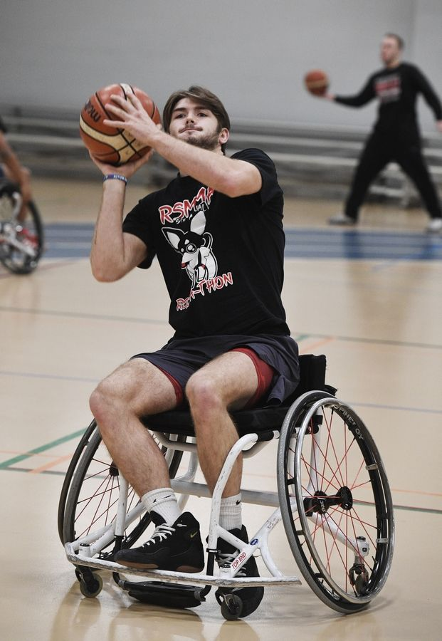 Harper College student and wrestler John Wright attempts a shot during a wheelchair basketball demonstration Tuesday at the inaugural Harper College Adaptive Sports Day in Palatine.
