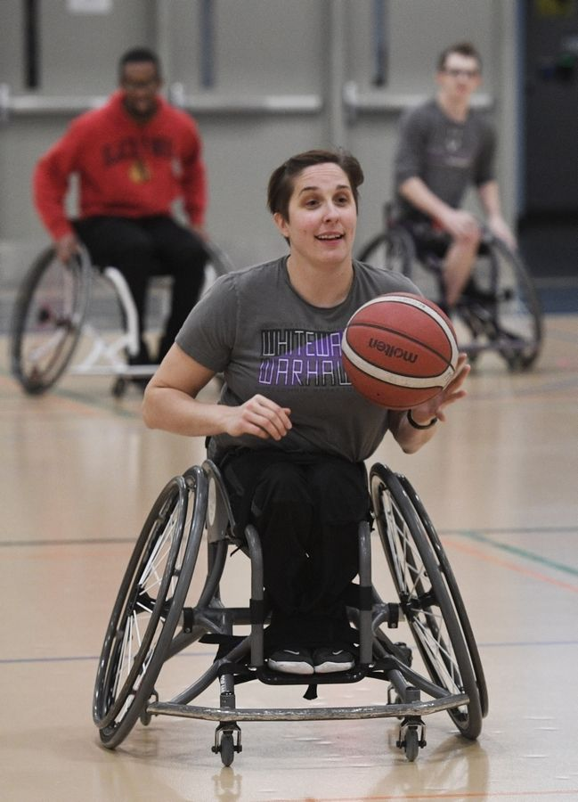 University of Wisconsin-Whitewater women's wheelchair basketball coach Christina Schwab brings the ball up court Tuesday during the inaugural Harper College Adaptive Sports Day in Palatine.
