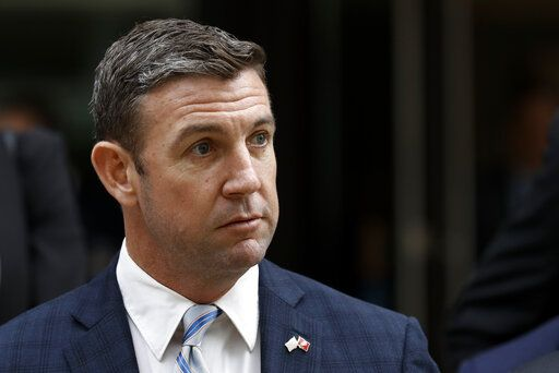California Republican Rep. Duncan Hunter leaves federal court Tuesday, Dec. 3, 2019, in San Diego. Hunter gave up his year-long fight against federal corruption charges and pleaded guilty Tuesday to misusing his campaign funds, paving the way for the six-term Republican to step down.