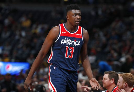 Washington Wizards center Thomas Bryant heads to the bench after drawing two quick fouls against the Denver Nuggets in the first half of an NBA basketball game Tuesday, Nov. 26, 2019, in Denver.