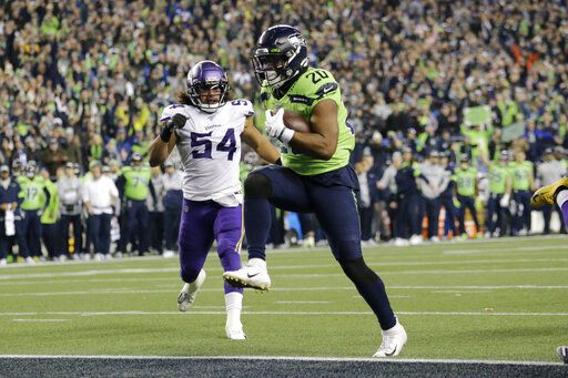 Seattle Seahawks' Rashaad Penny high steps into the end zone for a touchdown against the Minnesota Vikings during the second half of an NFL football game, Monday, Dec. 2, 2019, in Seattle.