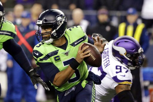 Seattle Seahawks quarterback Russell Wilson (3) scrambles against the Minnesota Vikings during the first half of an NFL football game, Monday, Dec. 2, 2019, in Seattle.