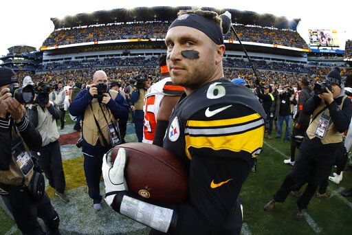 Pittsburgh Steelers quarterback Devlin Hodges (6) stands on the field with a game ball after a 20-13 Steelers win over the Cleveland Browns in an NFL football game in Pittsburgh, Sunday, Dec. 1, 2019.