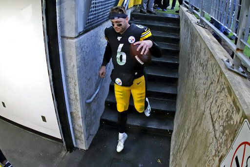 Pittsburgh Steelers quarterback Devlin Hodges heads to the locker room with a game ball following an NFL football game against the Cleveland Browns in Pittsburgh, Sunday, Dec. 1, 2019.