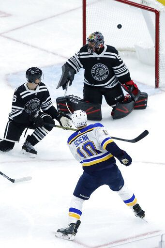 St. Louis Blues' Brayden Schenn (10) shoots and scores past Chicago Blackhawks goaltender Corey Crawford, top right, as Blackhawks' Olli Maatta watches during the third period of an NHL hockey game Monday, Dec. 2, 2019, in Chicago.