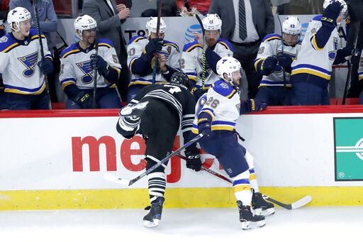 St. Louis Blues' Nathan Walker (26) sidesteps Chicago Blackhawks' Brent Seabrook, forcing Seabrook into the boards, during the second period of an NHL hockey game Monday, Dec. 2, 2019, in Chicago.