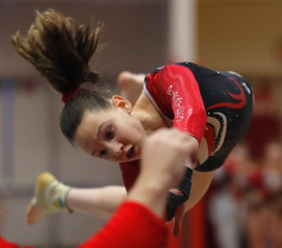 Palatine's Emily Ziemba performs on the vault in varsity girls gymnastics at Palatine High School Wednesday.