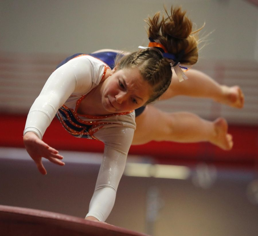 Buffalo Grove's Anna Lang performs on the vault in varsity girls gymnastics at Palatine High School Wednesday.