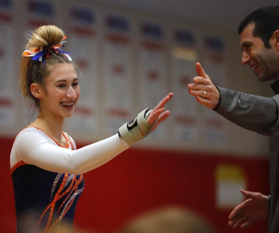 Buffalo Grove's Leah Oyen is all smiles after her vault in varsity girls gymnastics at Palatine High School Wednesday.