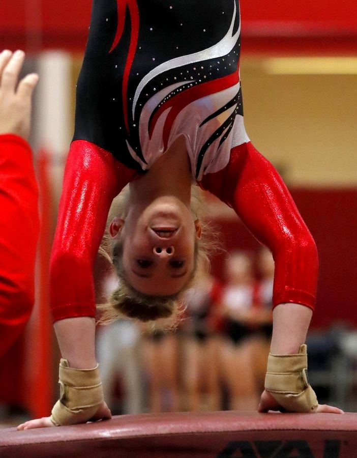 Palatine's Riley Strahl performs on the vault in varsity girls gymnastics at Palatine High School Wednesday.