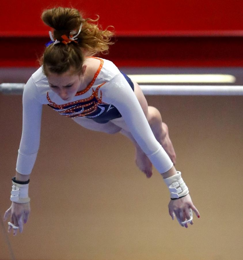 Buffalo Grove's Hannah Greenspan performs on the bars in varsity girls gymnastics at Palatine High School Wednesday.