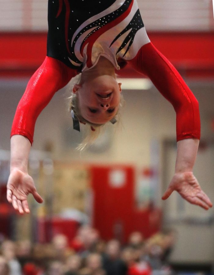Palatine's Elly Nilsen performs on the vault in varsity girls gymnastics at Palatine High School Wednesday.