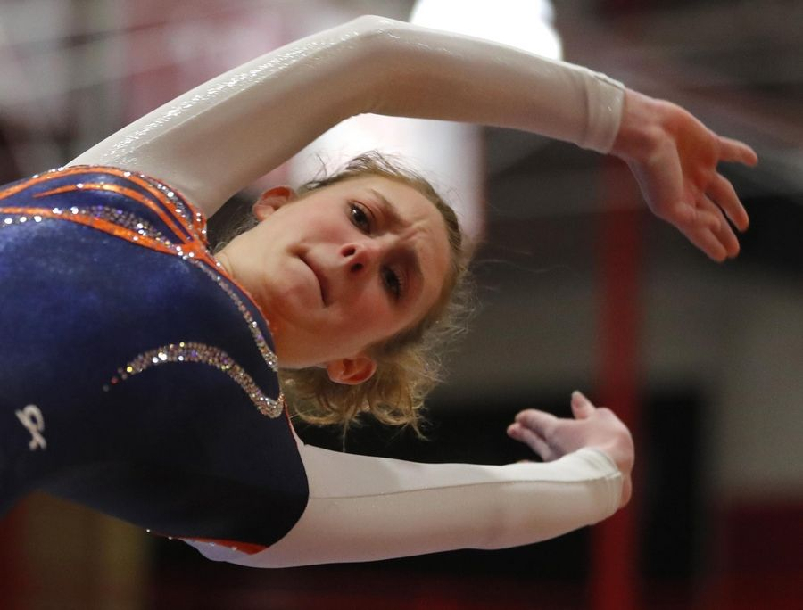 Buffalo Grove's Hannah Greenspan performs on the vault in varsity girls gymnastics at Palatine High School Wednesday.