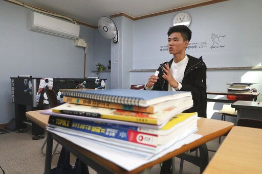 In this Nov. 1, 2019, photo, Kim Hyun-seung from Tianjin, China, 20, speaks during an interview at the South-North Love School in Seoul, South Korea. Kim arrived in South Korea three years ago to reunite with his mother, who came six years earlier. Kim's 52-year-old mother, Kim So-yeon, described him as 'œa great, loyal son,'� who tried not to talk much about his suffering and once cooked special foods for her on her birthday.