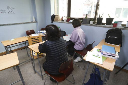 In this Nov. 1, 2019, photo, 20 years old student Choe, right, born to a North Korean refugee mother and a Chinese father, and her North Korean mother Choe H.Y. sit during an interview at the South-North Love School in Seoul, South Korea. Hundreds of children born to North Korean women and Chinese men have resettled in South Korea, but life is often tough. They didn't want their full names and faces to be revealed because of worries that media publicity could hurt their life in South Korea.
