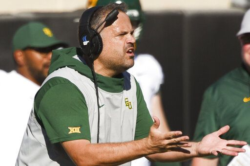 FILE - In this Oct. 19, 2019, file photo, Baylor head coach Matt Rhule gestures to an official during the first half of an NCAA college football game against Oklahoma State, in Stillwater, Okla. Baylor coach Matt Rhule and Oklahoma's Lincoln Riley took over their teams under drastically different circumstances. Now they will coach against each other in the Big 12 championship game.