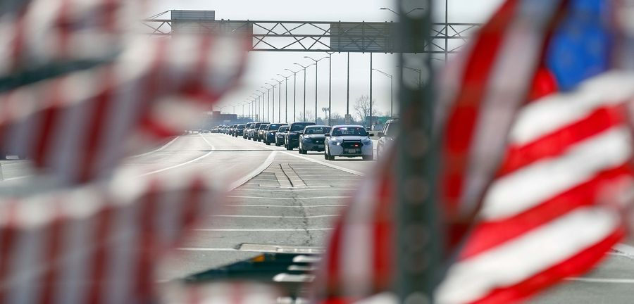 "A procession of state police and other vehicles moves along a portion of I-294 near Willow Road that was dedicated Thursday as ""Trooper Christopher Lambert Highway"" in memory of a trooper killed there Jan. 12 when he was struck by an SUV while assisting other drivers involved in a crash."