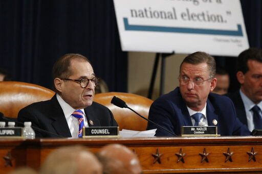 House Judiciary Committee ranking member Rep. Doug Collins, R-Ga., looks over to Chairman Rep. Jerrold Nadler, D-N.Y., left, as he speaks during a hearing before the House Judiciary Committee on the constitutional grounds for the impeachment of President Donald Trump, on Capitol Hill in Washington, Wednesday, Dec. 4, 2019. Republican counsel Paul Taylor, right.