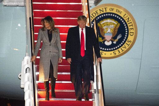 President Donald Trump and first lady Melania Trump arrive on Air Force One on Wednesday, Dec. 4, 2019, at Andrews Air Force Base, Md., following a trip to the NATO Summit in England.