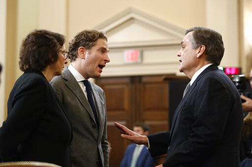 Harvard Law School professor Noah Feldman, Stanford Law School professor Pamela Karlan and George Washington University Law School professor Jonathan Turley talk during a break in a hearing before the House Judiciary Committee on the constitutional grounds for the impeachment of President Donald Trump, on Capitol Hill in Washington, Wednesday, Dec. 4, 2019.