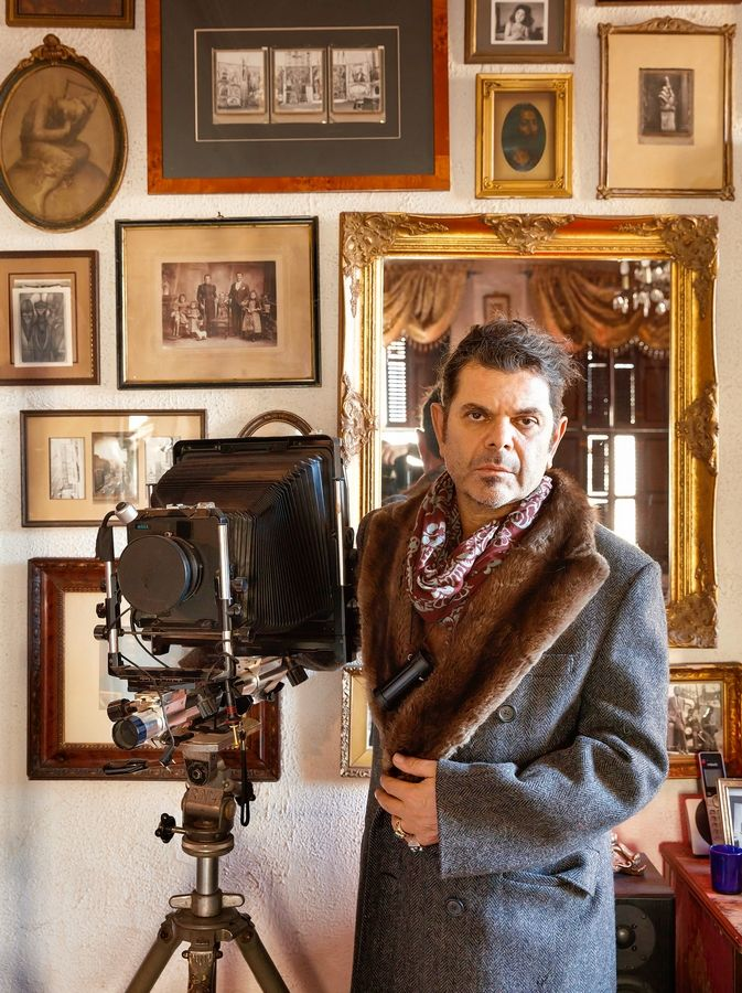 "This photo provided by Monacelli Press shows Tony Notarberardino inside his apartment in the Chelsea Hotel in New York and is featured in the book by Colin Miller and Ray Mock titled ""Hotel Chelsea: Living in the Last Bohemian Haven."" The book is a big, colorful celebration of more than two dozen residents, their living spaces and their stories. (Colin Miller/Monacelli Press via AP)"