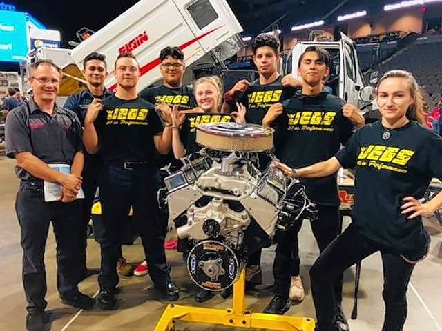 South Elgin High School's automotive technology team will compete next week against nine other teams in a national contest to determine the fastest engine teardown. From left are, instructor Steve Schertz, students Dan Godinez, Hayden Shaw, Omar Quiroz, Casey Gebala, Jared Pena, Andrew Clark, and team coach and alumna LeeAnn Driscoll.