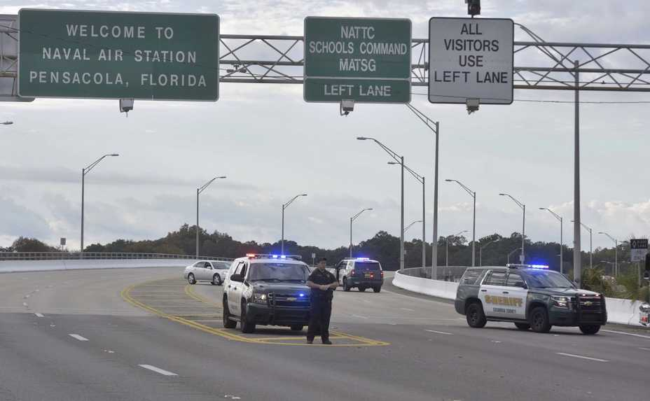 Police vehicles block the entrance Friday to the Pensacola Air Base in Pensacola, Florida. The U.S. Navy is confirming that a shooter is dead and several injured after gunfire at the Naval Air Station in Pensacola.