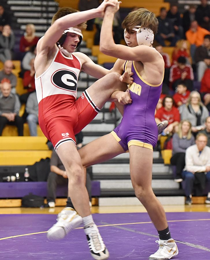 Wauconda's Colin Husko trips Grant's Justin Warmowski in their 132-pound wrestling match in Wauconda Friday.