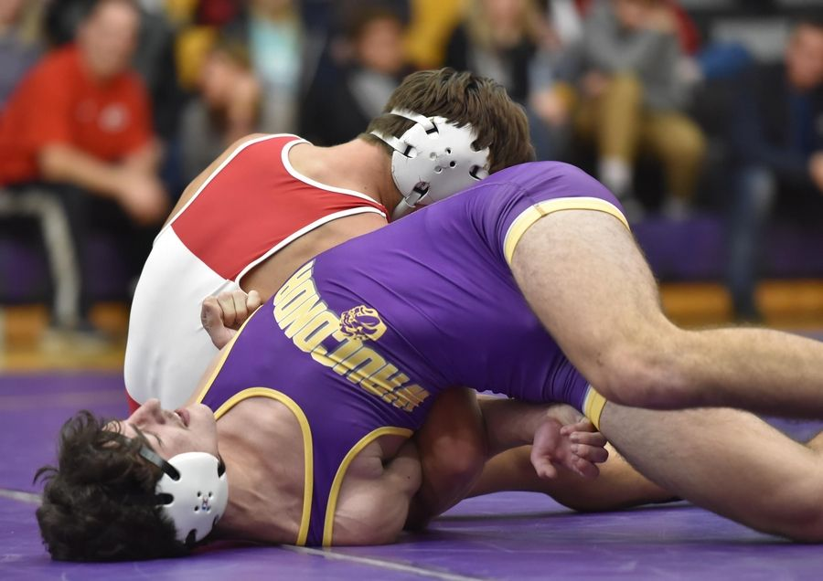 Wauconda's Collin Cheshier is controlled by Grant's Eddy Tregenza III in their 160-pound wrestling match in Wauconda Friday.