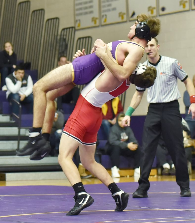Grant's Dylan Rinkenberger throws Wauconda's Nick Bennett in their 152-pound wrestling match in Wauconda Friday.