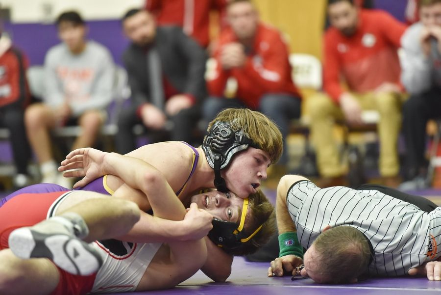 The referee watches closely as Wauconda's Dennis Kloss holds Grant's Bradley Berg near a pin in their 145-pound wrestling match in Wauconda Friday.