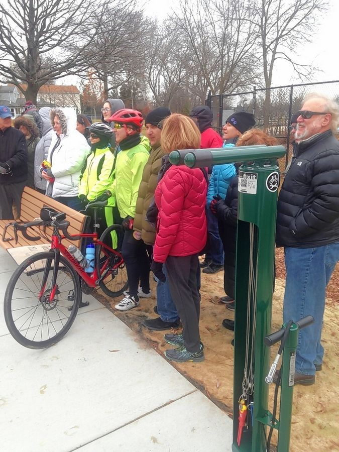Members of local bike clubs who raised money for a bench and repair station in Frontier Park in Arlington Heights gather for a ceremony Saturday dedicating them to the memory of local biking enthusiast Jim Shoemaker.