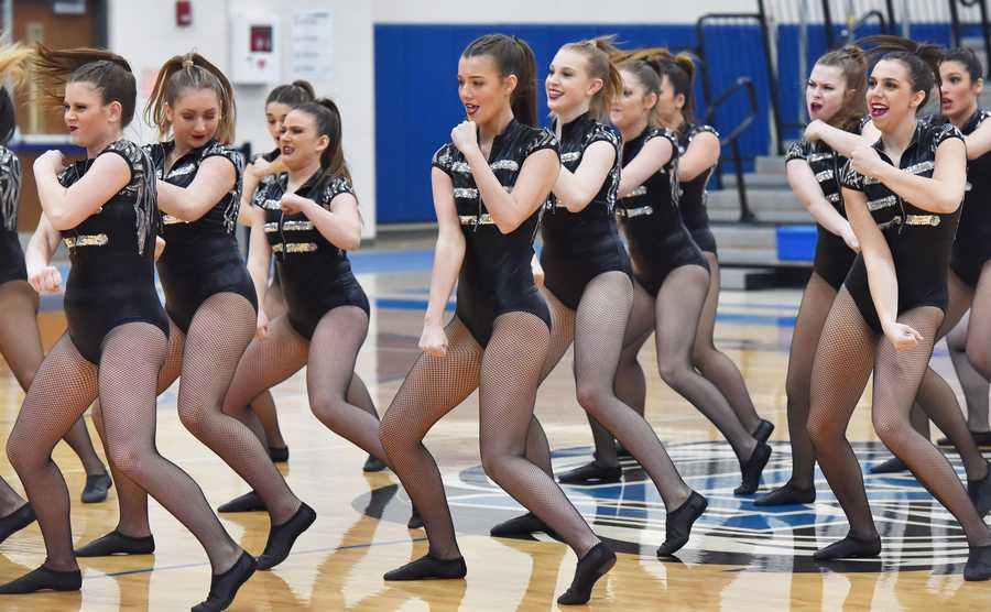 Fremd High School dancers dress in black and silver as they perform at the Bear Invitational high school dance competition at Lake Zurich High School Saturday.