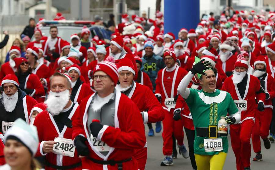 "George Dulian of Elk Grove Village dressed as Buddy the Elf waves as hundreds of runners and walkers dressed as everyone's favorite jolly old elf took to the streets of downtown Arlington Heights on Saturday, Dec. 7, for the seventh annual Rotary Santa Run. The race featured a 5K race through a traffic-free course, as well as a 1-mile walk for those who prefer a slower pace and a four-block ""Reindeer Run"" for kids 10 and under. The event is hosted by the Rotary Club of Arlington Heights and raises money for its annual Community Grants Program. To date, the club has donated more than $250,000 to worthy causes throughout Arlington Heights and neighboring communities, directly as a result of the Santa Run."