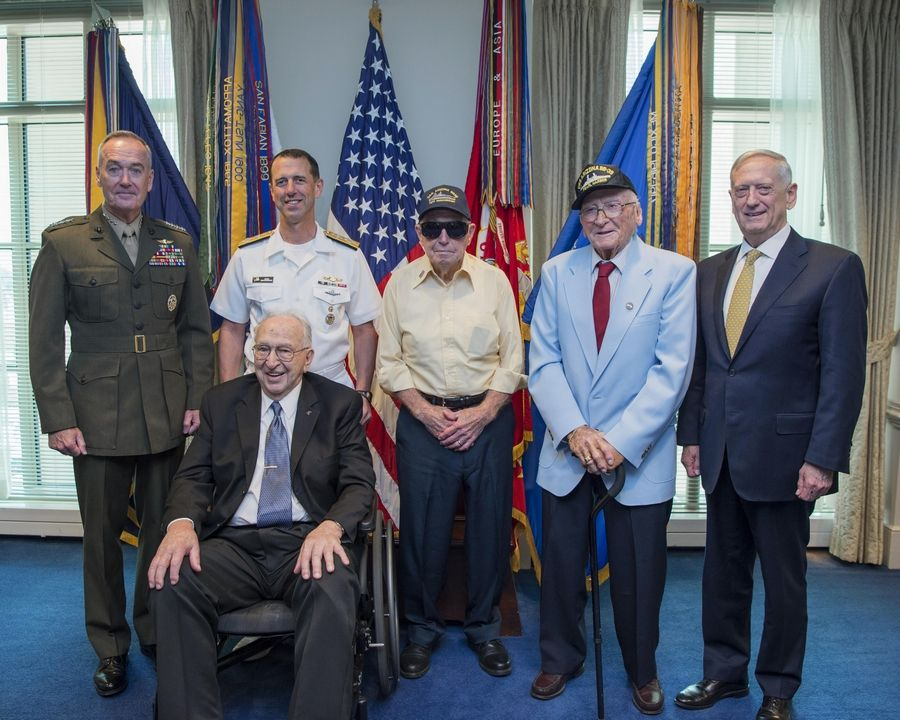 Survivors from the USS Arizona meet with military leaders at the Pentagon in Washington in July 2017. From left to right are U.S. Marine Gen. Joseph Dunford, Chairman of the Joint Chiefs of Staff; U.S. Navy Adm. John Richardson, Chief of Naval Operations; Lauren Bruner, who served as a fire controlman third class; Ken Potts, an Illinoisan who served as a coxswain; Donald Stratton, who served as a seaman first class; and Secretary of Defense Jim Mattis.