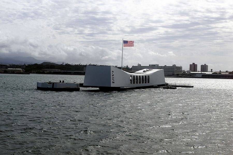 The U.S. flag waves over the USS Arizona Memorial in Pearl Harbor, Hawaii, marking the spot where the battleship sank 60 years ago.