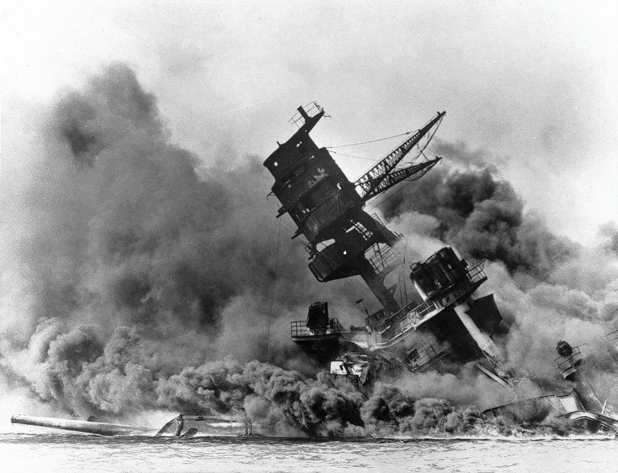 In this Dec. 7, 1941, photo, smoke rises from the battleship USS Arizona as it sinks during a Japanese surprise attack on Pearl Harbor, Hawaii.