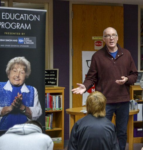Filmmaker Ted Green talks about keeping Eva Kor's legacy alive through education at Sullivan High School in Sullivan, Ind., on Monday, Nov. 25, 2019, at the school in Sullivan, Ind. (Austen Leake/Tribune-Star via AP)