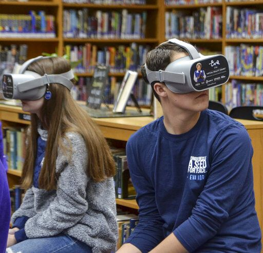 "Sullivan High School freshman Jacob Hawkins uses a VR headset to experience ""Virtual Reality: An Eva Experience"" on Monday, Nov. 25, 2019, at the school in Sullivan, Ind. (Austen Leake/Tribune-Star via AP)"