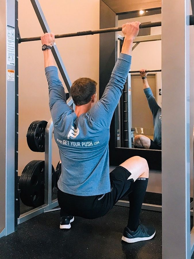 Yep, this is a pullup -- an assisted pullup, that is, which engages the lower body in addition to the upper body and hits the cardiovascular system as well.
